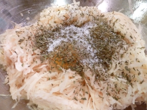 Adding Eggs, Salt, and Spices to the Latke Batter
